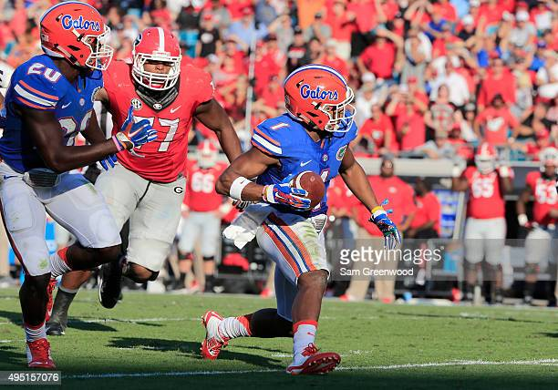 Vernon Hargreaves III of the Florida Gators rushes for a touchdown following a interception during the game against the Georgia Bulldogs at EverBank...