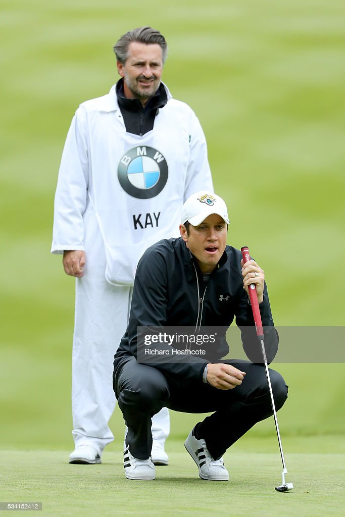 <a gi-track='captionPersonalityLinkClicked' href=/galleries/search?phrase=Vernon+Kay&family=editorial&specificpeople=211386 ng-click='$event.stopPropagation()'>Vernon Kay</a> lines up during the Pro-Am prior to the BMW PGA Championship at Wentworth on May 25, 2016 in Virginia Water, England.