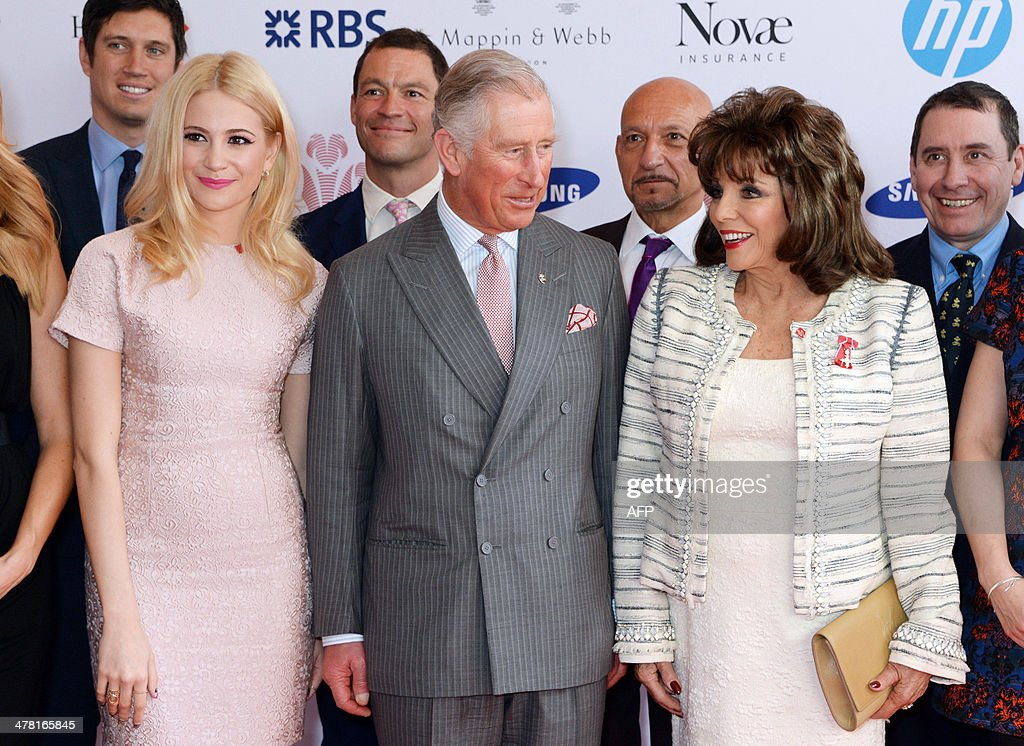 Vernon Kay, Pixie Lott, Dominic West, Britain's Prince Charles, Prince of Wales, Sir Ben Kingsley, Joan Collins and Jools Holland pose for a group photo during the Prince's Trust & Samsung Celebrate Success Awards at Odeon Leicester Square in Central London on March 12, 2014.