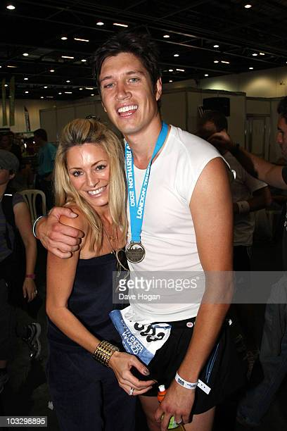 Vernon Kay with his medal poses with wife Tess Daly after competing in the Challenger World London Triathlon 2010 at ExCel London on August 8 2010 in...