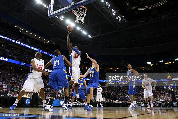 Vernon Macklin of the Florida Gators attempts a shot against Greg Somogyi of the UC Santa Barbara Gauchos during the second round of the 2011 NCAA...