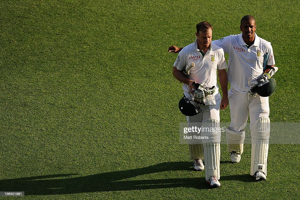 Vernon Philander and AB de Villers (L) of South Africa leave the field at the end of day five of the First Test match between Australia and South Africa at The Gabba on November 13, 2012 in Brisbane, Australia.