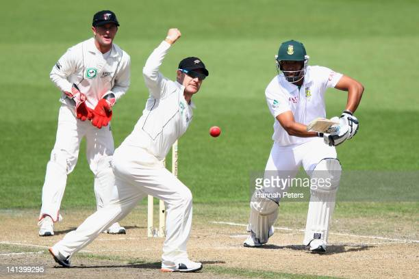 Vernon Philander of Sout Africa hits the ball past Brendon McCullum of New Zealand during day two of the Second Test match between New Zealand and...