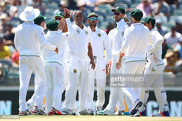Vernon Philander of South Africa celebraes with team mates after dimissing Mitch Marsh of Australia during day two of the First Test match between...