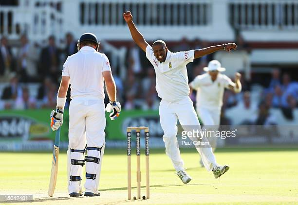 Vernon Philander of South Africa celebrates taking the wicket of Ian Bell of England for 58 runs after he was caught out by Alviro Petersen of South...