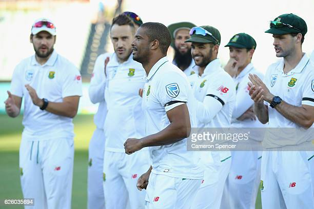 Vernon Philander of South Africa is applauded by team mates after being named player of the series during day four of the Third Test match between...