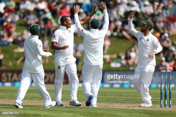 Vernon Philanders of South Africa celebrates the dismissal of Tom Latham of New Zealand during day two of the First Test match between New Zealand...