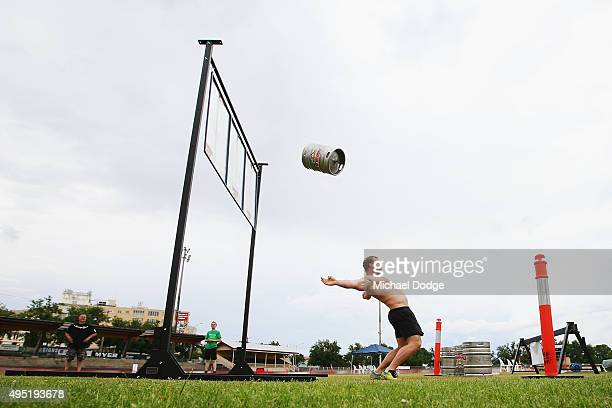 Vernon Van Schalkwyk throws five kegs of beer in a row in quickest time to win the Keg Throw discipline in the Victorian Strongman contest during...