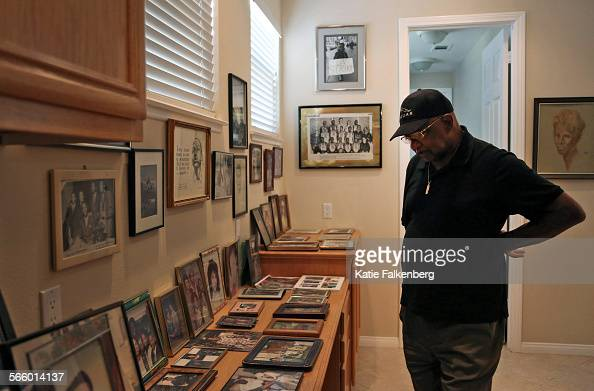 Vernon Watkins whose life was energized and influenced by the March on Washington which he went to at age 24 pauses by his table and wall of family...