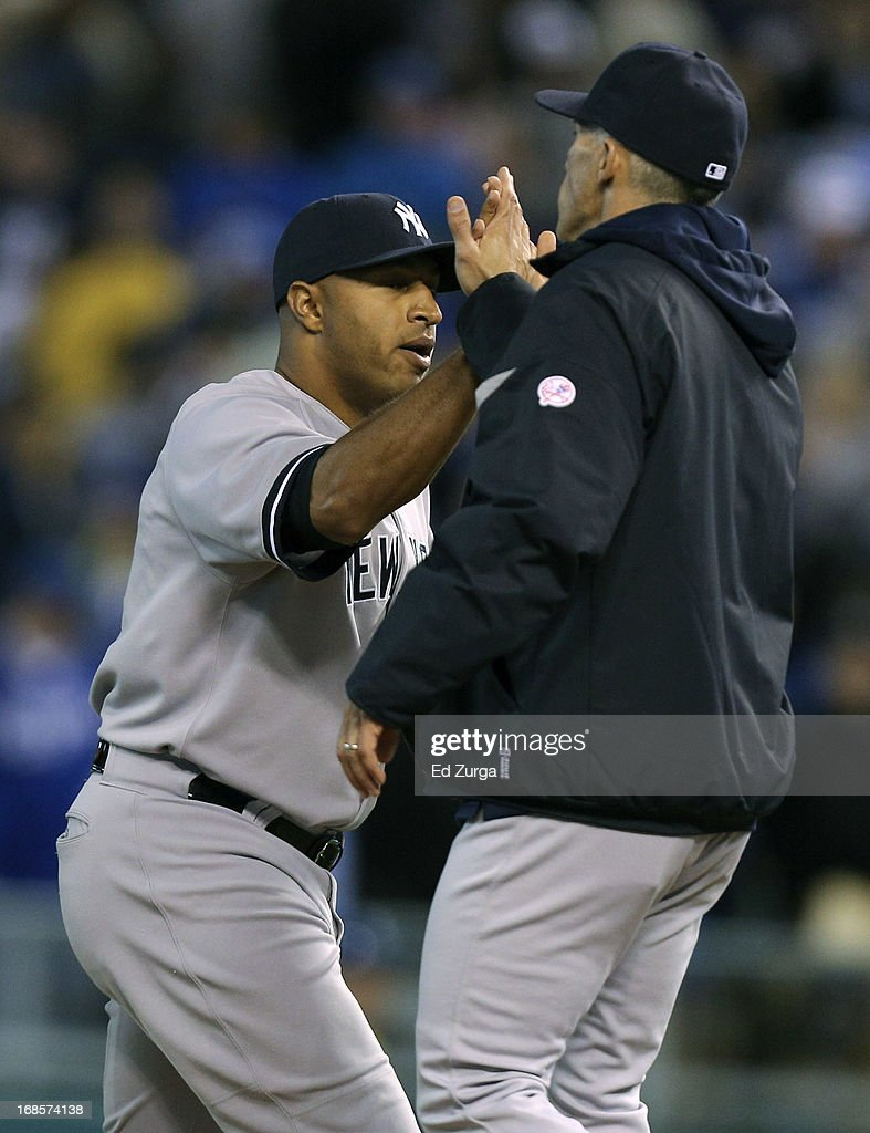 <a gi-track='captionPersonalityLinkClicked' href=/galleries/search?phrase=Vernon+Wells&family=editorial&specificpeople=212943 ng-click='$event.stopPropagation()'>Vernon Wells</a> of the New York Yankees and <a gi-track='captionPersonalityLinkClicked' href=/galleries/search?phrase=Joe+Girardi&family=editorial&specificpeople=208659 ng-click='$event.stopPropagation()'>Joe Girardi</a> celebrate a win over the Kansas City Royals at Kauffman Stadium on May 11, 2013 in Kansas City, Missouri.