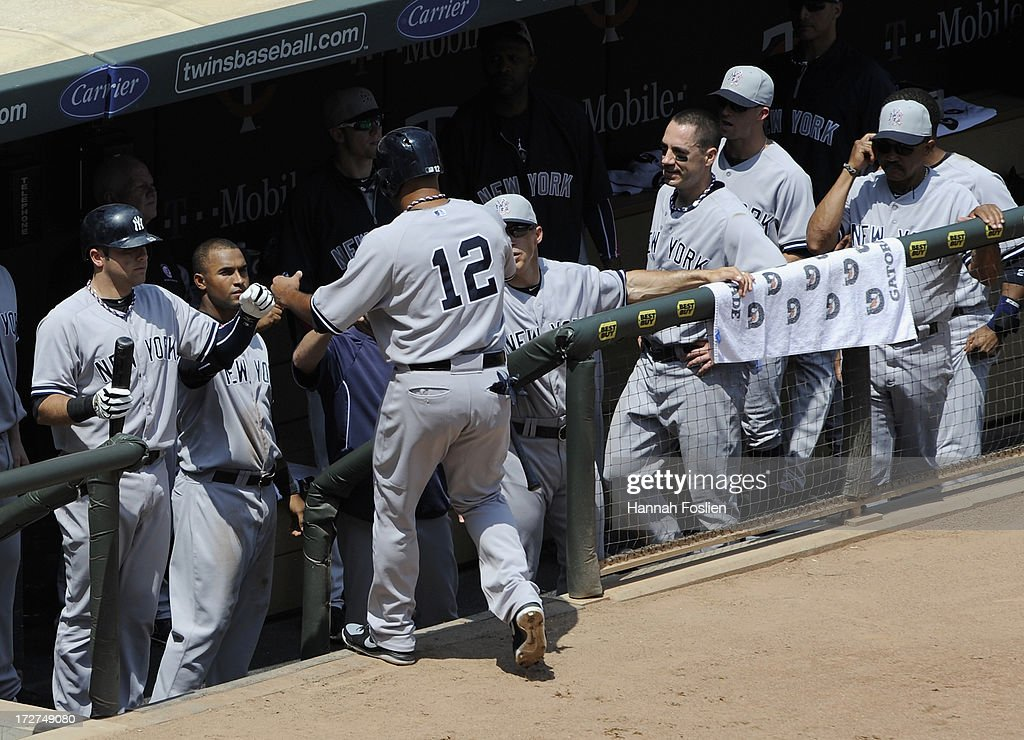 <a gi-track='captionPersonalityLinkClicked' href=/galleries/search?phrase=Vernon+Wells&family=editorial&specificpeople=212943 ng-click='$event.stopPropagation()'>Vernon Wells</a> #12 of the New York Yankees celebrates scoring a run against the Minnesota Twins during the third inning of the game on July 4, 2013 at Target Field in Minneapolis, Minnesota. The Yankees defeated the Twins 9-5.