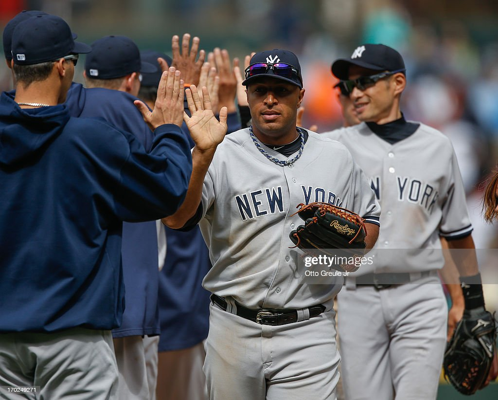 <a gi-track='captionPersonalityLinkClicked' href=/galleries/search?phrase=Vernon+Wells&family=editorial&specificpeople=212943 ng-click='$event.stopPropagation()'>Vernon Wells</a> #12 of the New York Yankees celebrates with teammates after defeating the Seattle Mariners 2-1 at Safeco Field on June 9, 2013 in Seattle, Washington.