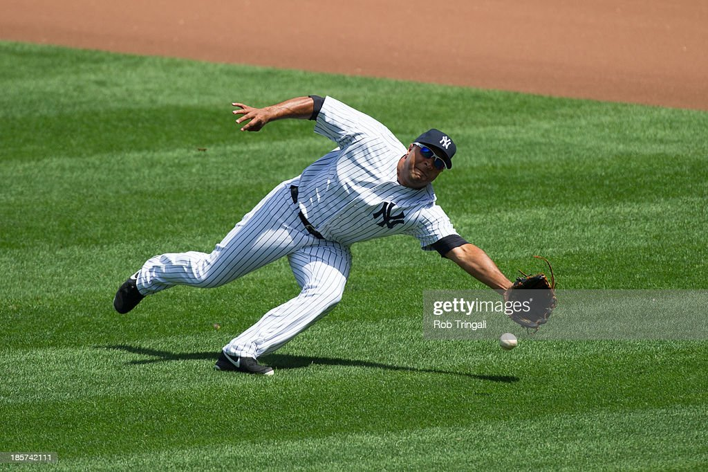 Vernon Wells of the New York Yankees dives for the ball during the game against the Los Angeles Angels at Yankee Stadium on August 15 2013 in the...
