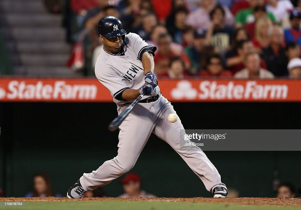 Vernon Wells of the New York Yankees hits a base hit against the Los Angeles Angels of Anaheim in the fourth inning at Angel Stadium of Anaheim on...