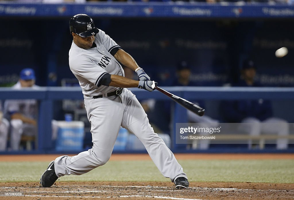 <a gi-track='captionPersonalityLinkClicked' href=/galleries/search?phrase=Vernon+Wells&family=editorial&specificpeople=212943 ng-click='$event.stopPropagation()'>Vernon Wells</a> #12 of the New York Yankees hits a solo home run in the seventh inning during MLB game action against the Toronto Blue Jays on April 19, 2013 at Rogers Centre in Toronto, Ontario, Canada.