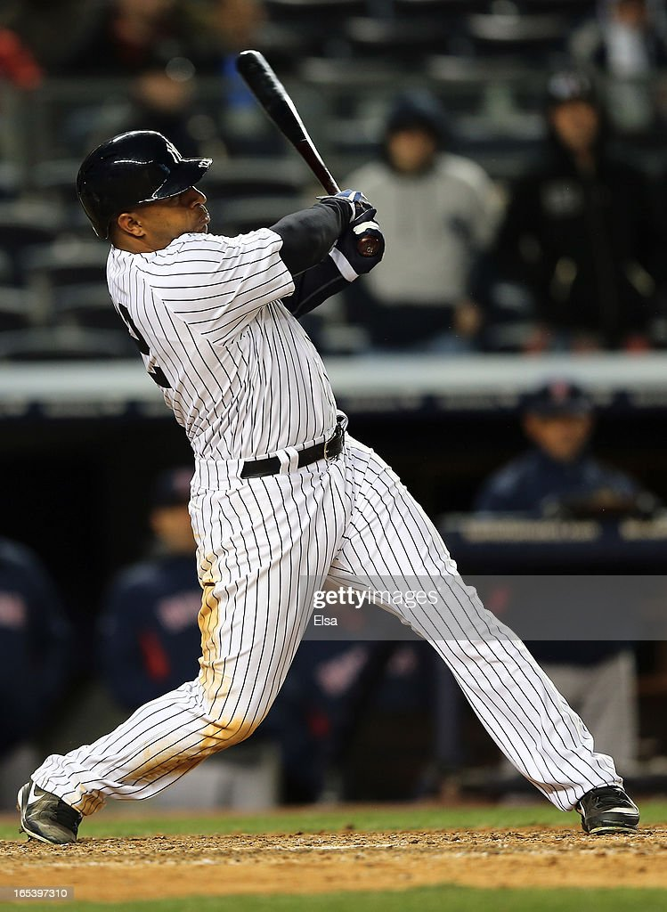 <a gi-track='captionPersonalityLinkClicked' href=/galleries/search?phrase=Vernon+Wells&family=editorial&specificpeople=212943 ng-click='$event.stopPropagation()'>Vernon Wells</a> #12 of the New York Yankees hits a three run home run in the eighth inning against the Boston Red Sox on April 3, 2013 at Yankee Stadium in the Bronx borough of New York City.