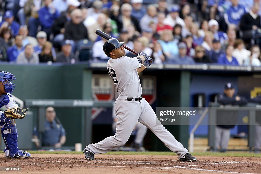<a gi-track='captionPersonalityLinkClicked' href=/galleries/search?phrase=Vernon+Wells&family=editorial&specificpeople=212943 ng-click='$event.stopPropagation()'>Vernon Wells</a> #12 of the New York Yankees hits the ball against the Kansas City Royals at Kauffman Stadium on May 11, 2013 in Kansas City, Missouri.
