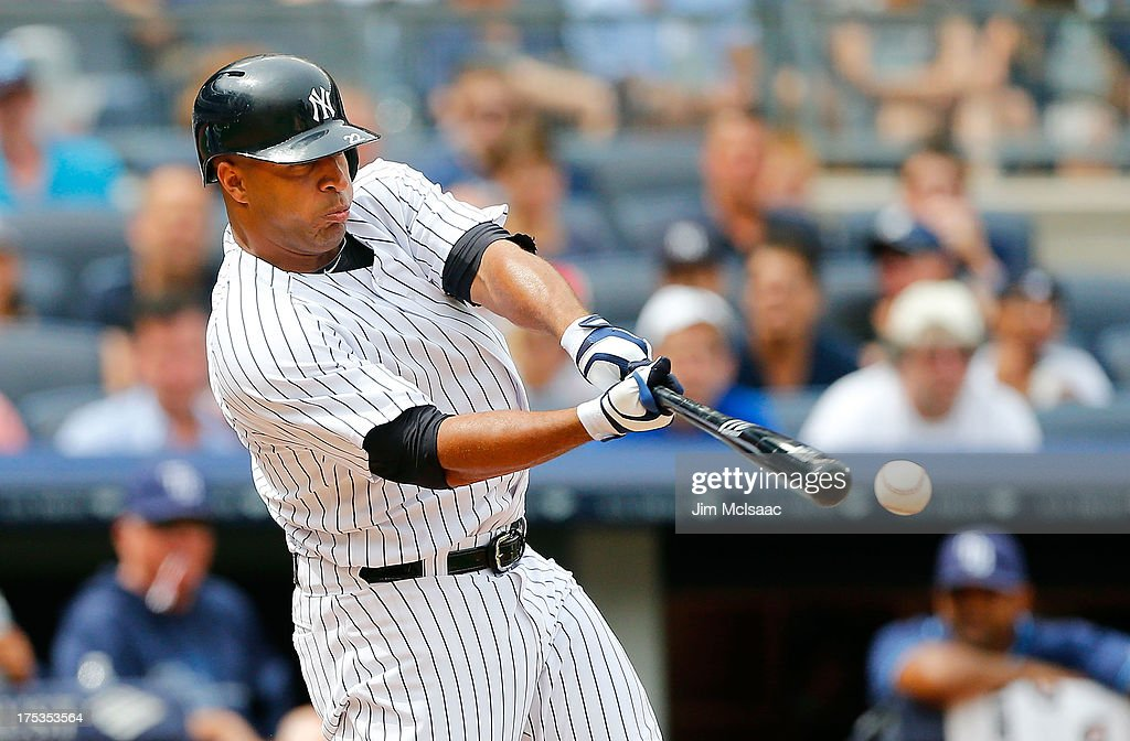 Vernon Wells of the New York Yankees in action against the Tampa Bay Rays at Yankee Stadium on July 28 2013 in the Bronx borough of New York City The...