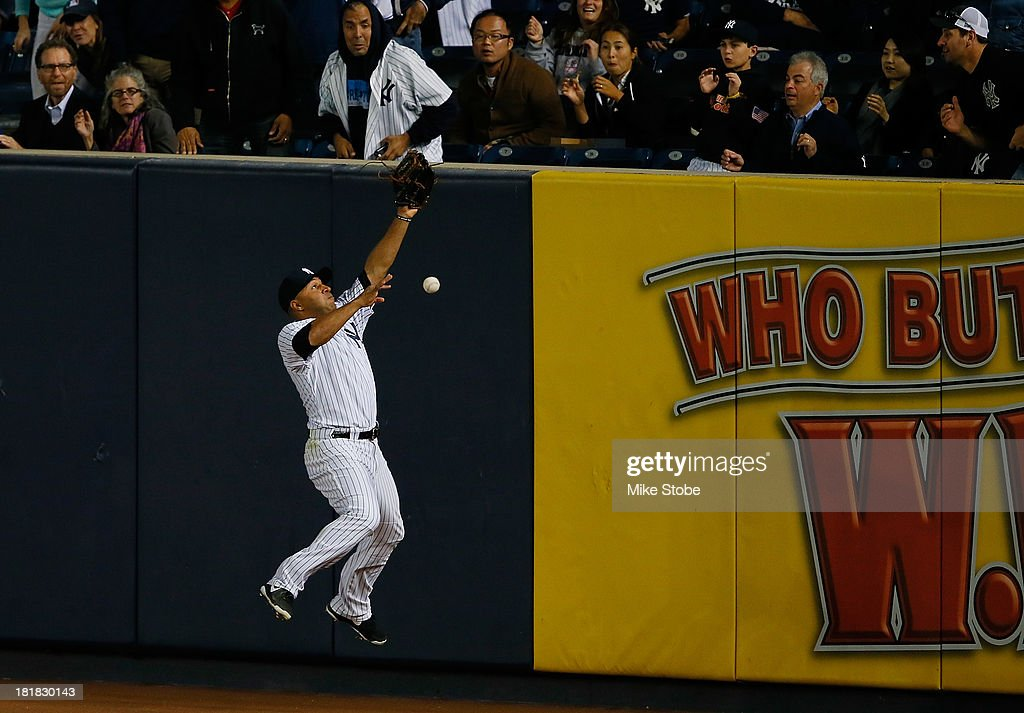 <a gi-track='captionPersonalityLinkClicked' href=/galleries/search?phrase=Vernon+Wells&family=editorial&specificpeople=212943 ng-click='$event.stopPropagation()'>Vernon Wells</a> #22 of the New York Yankees is unable to catch a double off the bat of James Loney #21 of the Tampa Bay Rays in the third inning at Yankee Stadium on September 25, 2013 in the Bronx borough of New York City. Rays defeated the Yankees 8-3.