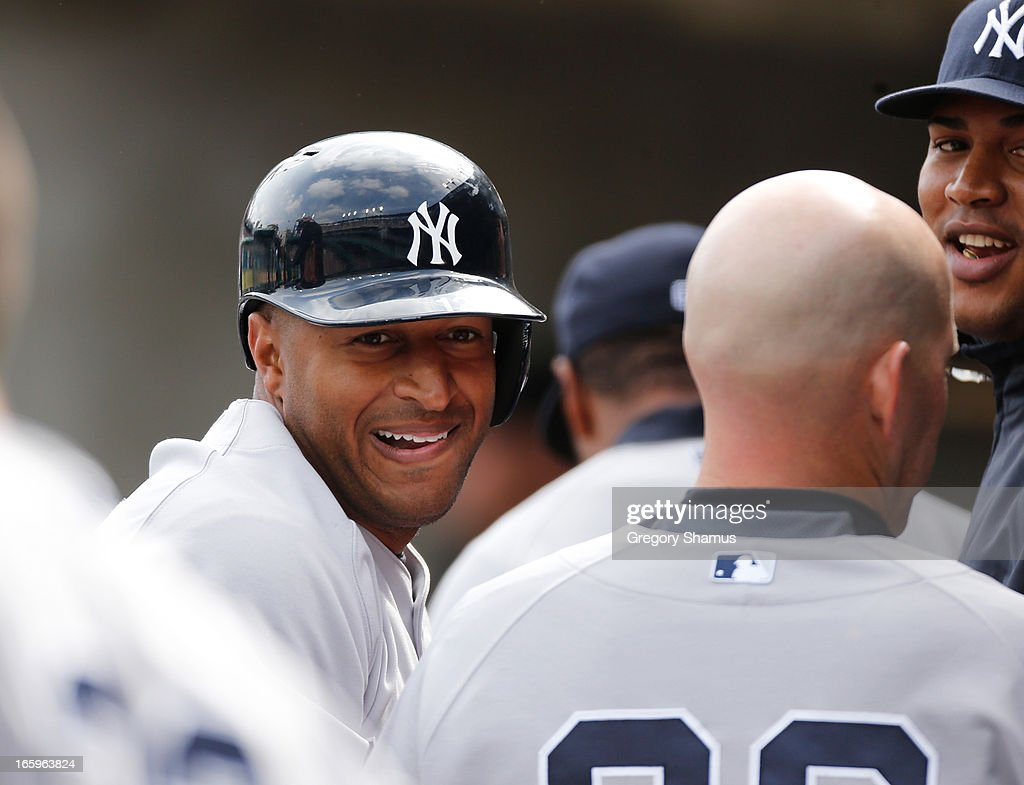 <a gi-track='captionPersonalityLinkClicked' href=/galleries/search?phrase=Vernon+Wells&family=editorial&specificpeople=212943 ng-click='$event.stopPropagation()'>Vernon Wells</a> #12 of the New York Yankees reacts with teammates in the dugout after scoring a run in the eighth inning while playing the Detroit Tigers at Comerica Park on April 7, 2013 in Detroit, Michigan. New York won the game 7-0.