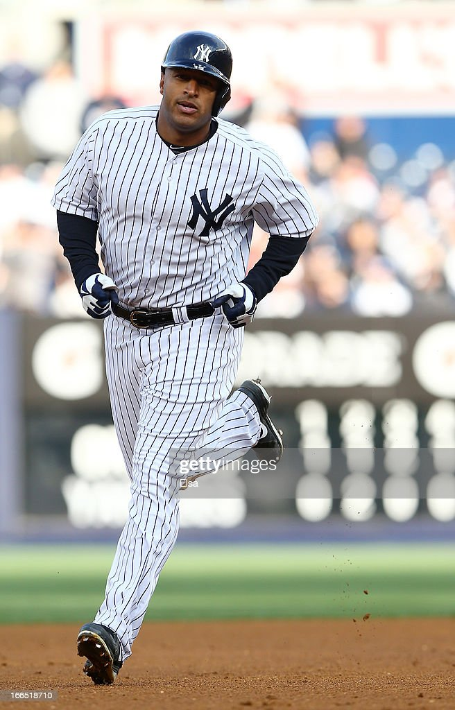<a gi-track='captionPersonalityLinkClicked' href=/galleries/search?phrase=Vernon+Wells&family=editorial&specificpeople=212943 ng-click='$event.stopPropagation()'>Vernon Wells</a> #12 of the New York Yankees rounds the bases after he hit a solo home run in the sixth inning against the Baltimore Orioles on April 13, 2013 at Yankee Stadium in the Bronx borough of New York City.