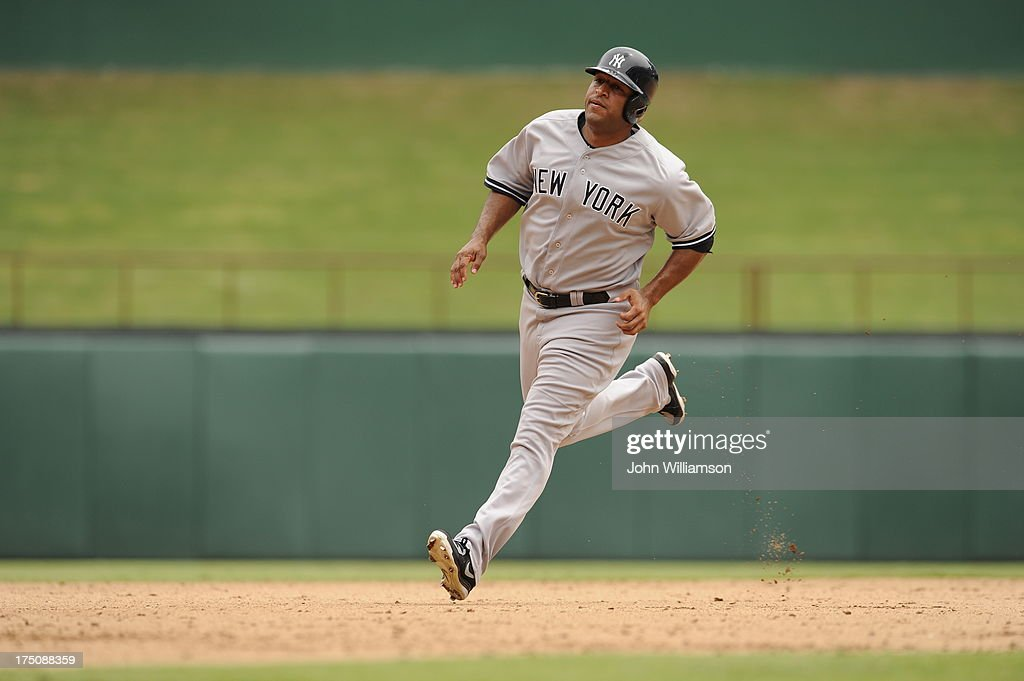 Vernon Wells of the New York Yankees runs the bases as the ball is put into play in the game against the Texas Rangers at Rangers Ballpark on July 25...