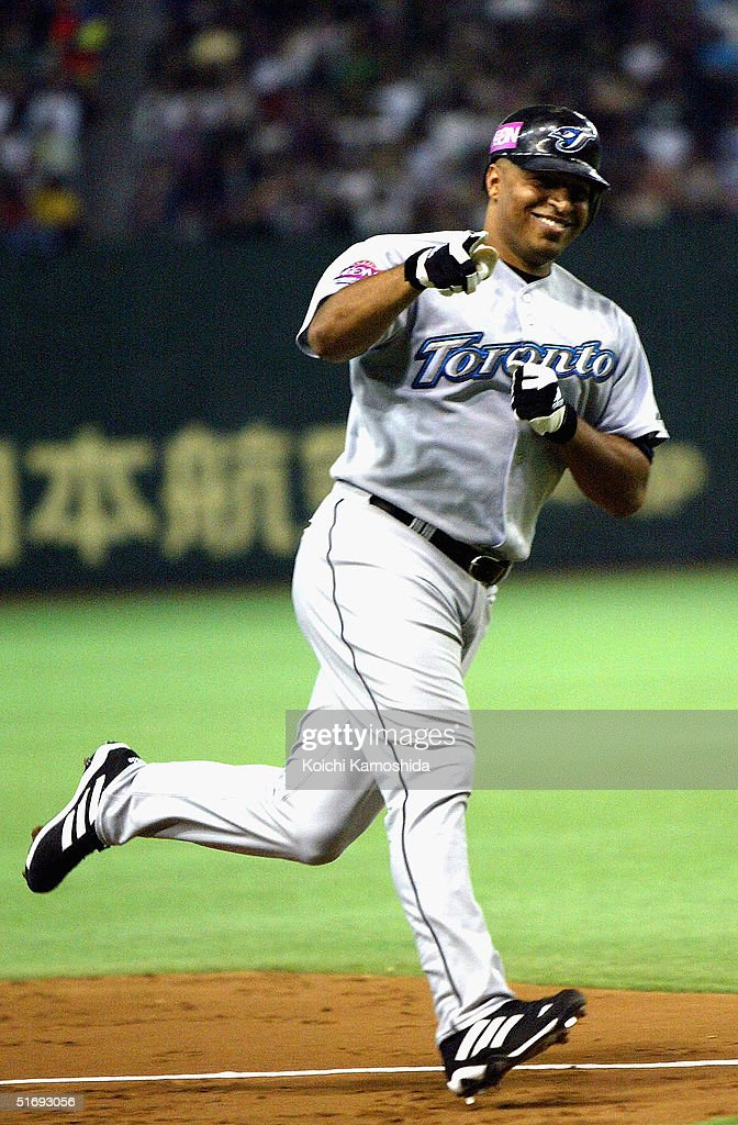 Vernon Wells of the Toronto Blue Jays rounds the bases after hitting a solo home run during the 3rd game of the exhibition series between US MLB and...