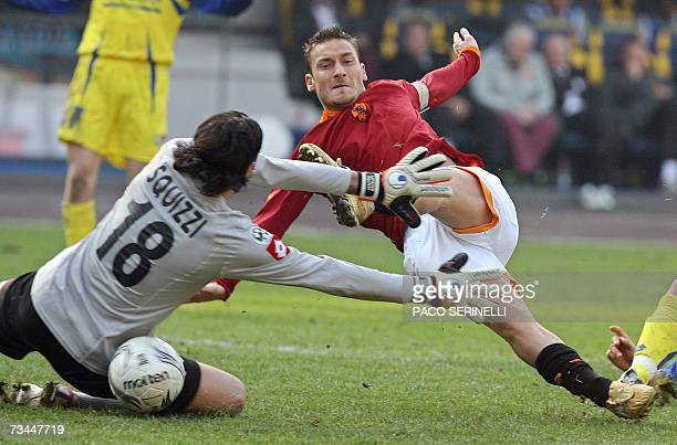 AS Roma's forward Francesco Totti scores despite of Chievo's goalkeeper Lorenzo Squinzi during their italian serie A football match at Bentegodi...