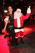 Verona Pooth and a Santa Claus actor during the Ein Herz Fuer Kinder Gala 2015 reception at Tempelhof Airport on December 5 2015 in Berlin Germany