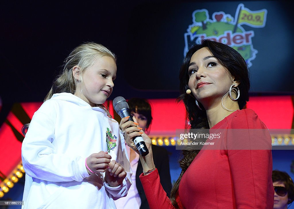 <a gi-track='captionPersonalityLinkClicked' href=/galleries/search?phrase=Verona+Pooth&family=editorial&specificpeople=156422 ng-click='$event.stopPropagation()'>Verona Pooth</a> and twelve year-old Naima are seen on stage during the Ferrero kinderTag 2013 event at Heidepark on September 19, 2013 in Soltau, Germany.