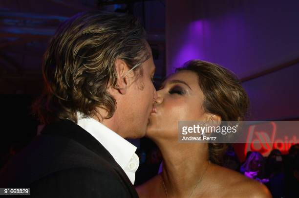 Verona Pooth kisses her husband Franjo Pooth at the after show party to 'Tribute To Bambi 2009' at The Station on October 9 2009 in Berlin Germany