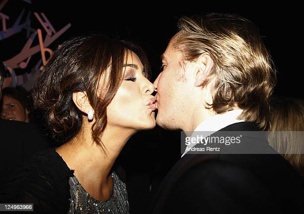 Verona Pooth kisses her husband Franjo Pooth at the annual Bertelmann party 2011 on September 14 2011 in Berlin Germany