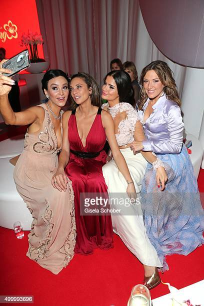 Verona Pooth Lilly Becker Shermine Shahrivar and Simone Ballack making a selfie during the Mon Cheri Barbara Tag 2015 at Postpalast on December 4...
