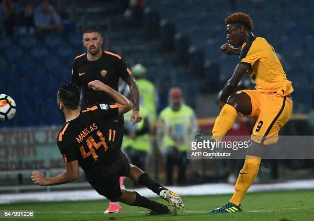 Verona's forward from Italy Moise Keen kicks the ball over AS Roma's defender from Greece Kostas Manolas during the Italian Serie A football match AS...