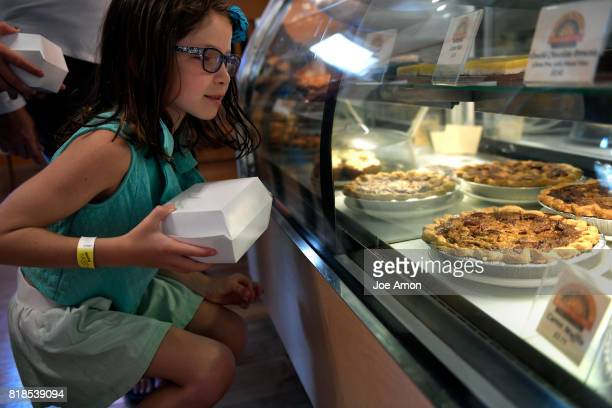 Veronica Adams 7 looking over pies and pastries at the Pagosa Baking Company in Pagosa Springs July 11 2017 Pagosa Springs CO