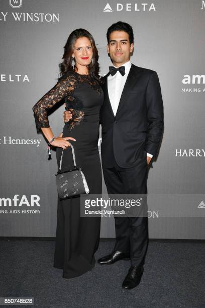 Veronica Berti and Amos Bocelli walks the red carpet of amfAR Gala Milano on September 21 2017 in Milan Italy
