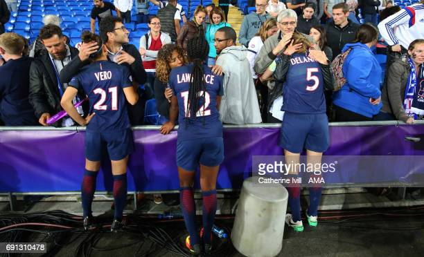 Veronica Boquete Ashley Lawrence and Sabrina Delannoy of PSG are consoled by their families after the UEFA Women's Champions League Final match...