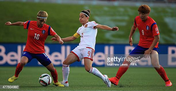 Veronica Boquete of Spain challenges for the ball with Kang Yumi and Park Eunsun of Korea Republic during the FIFA Women's World Cup 2015 Group E...