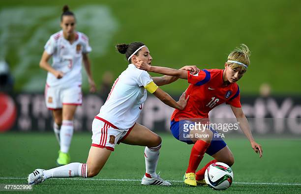 Veronica Boquete of Spain challenges Yumi Kang of Korea during the FIFA Women's World Cup 2015 Group E match between Korea Republic and Spain at...