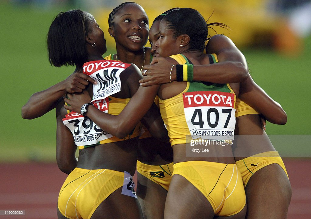 Veronica Campbell, <a gi-track='captionPersonalityLinkClicked' href=/galleries/search?phrase=Sherone+Simpson&family=editorial&specificpeople=730166 ng-click='$event.stopPropagation()'>Sherone Simpson</a>, <a gi-track='captionPersonalityLinkClicked' href=/galleries/search?phrase=Aleen+Bailey&family=editorial&specificpeople=769891 ng-click='$event.stopPropagation()'>Aleen Bailey</a> and Danielle Browning (407) embrace after teaming on Jamaica's runner-up women's 400-meter relay that timed 41.99 in the IAAF World Championships in Athletics at Olympic Stadium in Helsinki, Finland on Saturday, August 13, 2005.