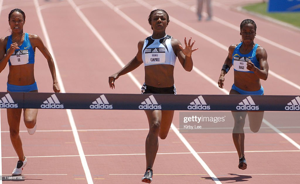 Veronica Campbell (center) wins the women's 100 meters in 10.96 seconds in the addas Track Classic at the Home Depot Center in Carson, Calif. on Sunday, May 22, 2005. Muna Lee (left) was second in 11.20 and Angela Daigle was third at 11.24.