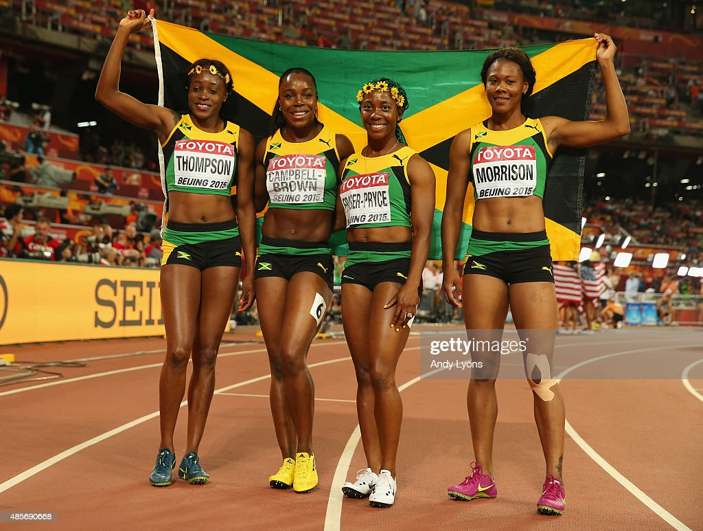 Veronica Campbell-Brown of Jamaica, Natasha Morrison of Jamaica, Elaine Thompson of Jamaica and Shelly-Ann Fraser-Pryce of Jamaica celebrate after winning gold in the Women's 4x100 Metres Relay final during day eight of the 15th IAAF World Athletics Championships Beijing 2015 at Beijing National Stadium on August 29, 2015 in Beijing, China.