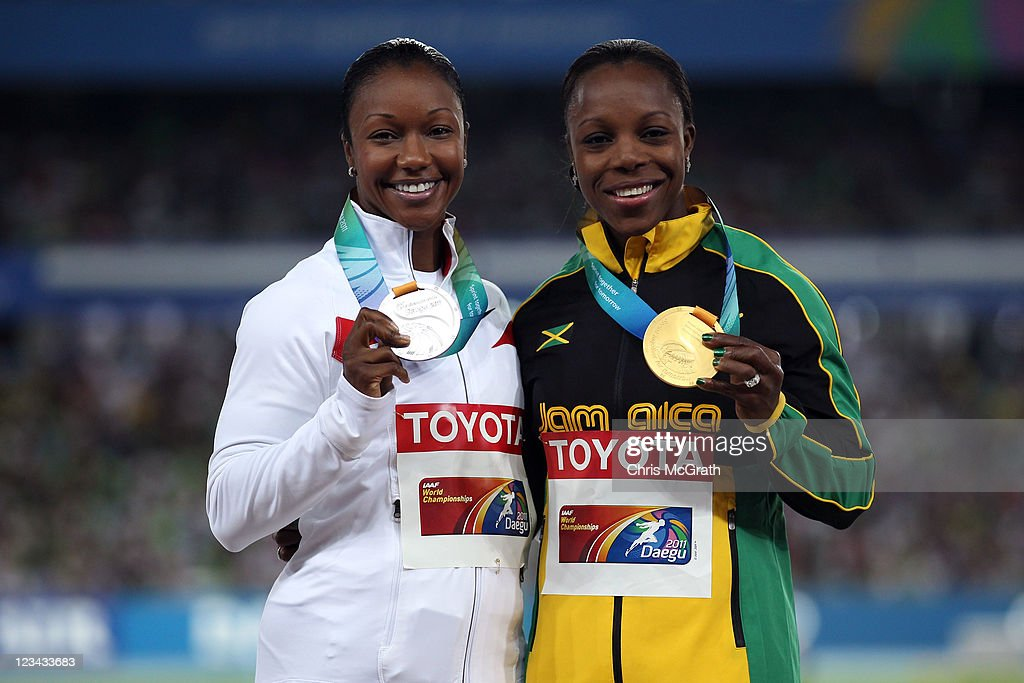 <a gi-track='captionPersonalityLinkClicked' href=/galleries/search?phrase=Veronica+Campbell-Brown&family=editorial&specificpeople=4861760 ng-click='$event.stopPropagation()'>Veronica Campbell-Brown</a> of Jamaica poses with her gold medal and <a gi-track='captionPersonalityLinkClicked' href=/galleries/search?phrase=Carmelita+Jeter&family=editorial&specificpeople=4472760 ng-click='$event.stopPropagation()'>Carmelita Jeter</a> of the USA the silver, Allyson Felix of the USA was absent due to competing in the 400 metres relay, during the medal ceremony for the women's 200 metres during day eight of 13th IAAF World Athletics Championships at Daegu Stadium on September 3, 2011 in Daegu, South Korea.