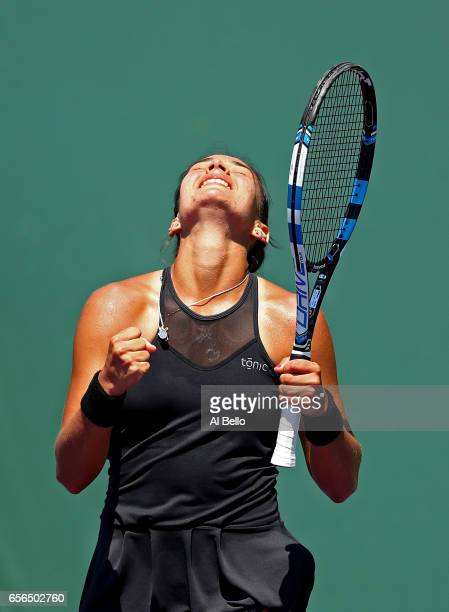 Veronica Cepede Royg of Paraguay celebrates match point against Misaki Doi of Japan during day 3 of the Miami Open at Crandon Park Tennis Center on...