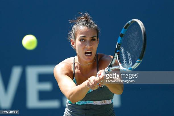 Veronica Cepede Royg of Paraguay competes against Kristie Ahn of the United States during day 2 of the Bank of the West Classic at Stanford...