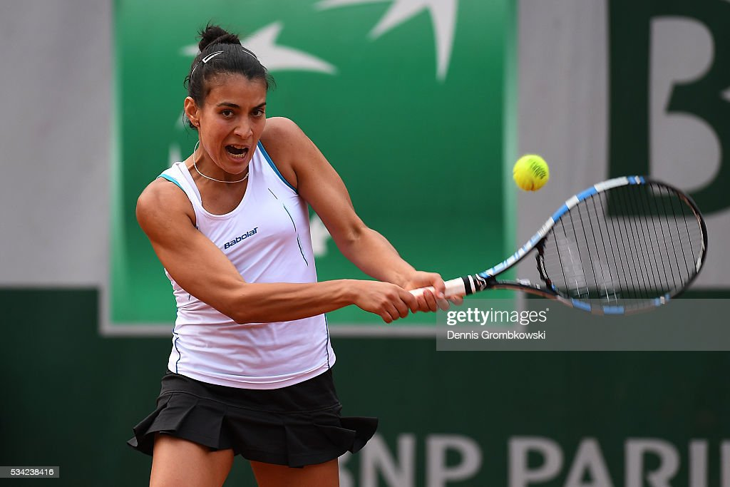 Veronica Cepede Royg of Paraguay plays a backhand during the Women's Singles second round match against Sloane Stephens of the United States on day four of the 2016 French Open at Roland Garros on May 25, 2016 in Paris, France.