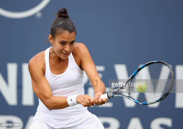 Veronica Cepede Royg of Paraguay returns a shot to Catherine Bellis of the United States during Day 4 of the Bank of the West Classic at Stanford...