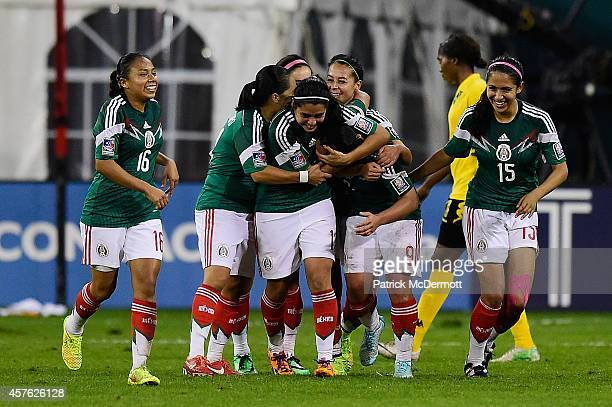 Veronica Charlyn Corral of Mexico celebrates with her teammates after scoring a goal in the second half of a game against Jamaica during the 2014...