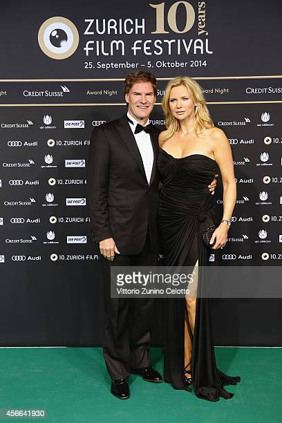Veronica Ferres and husband Carsten Maschmeyer attend the Award Night Green Carpet Arrivals during Day 10 of Zurich Film Festival 2014 on October 4...