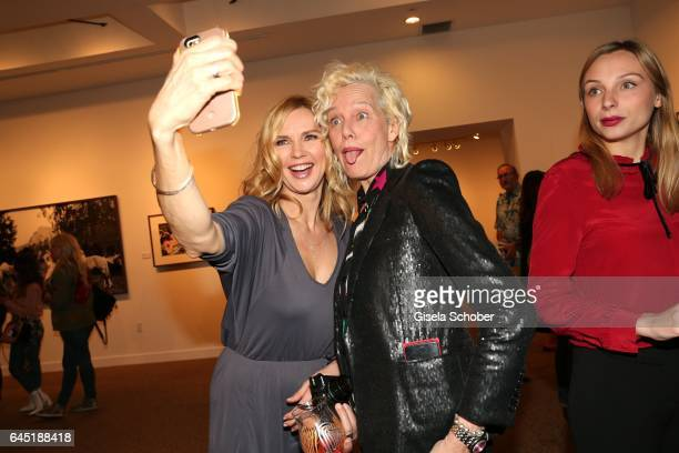Veronica Ferres and Photographer Ellen von Unwerth take a selfie during the opening night of Ellen von Unwerth's photo exhibition at TASCHEN Gallery...